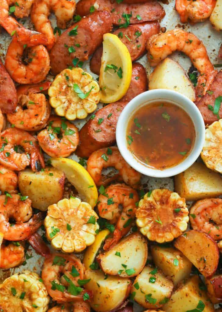 Cajun shrimp boil on a baking sheet with creole butter sauce