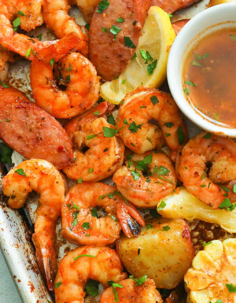 A close up shot of Cajun shrimp boil with Creole Butter sauce
