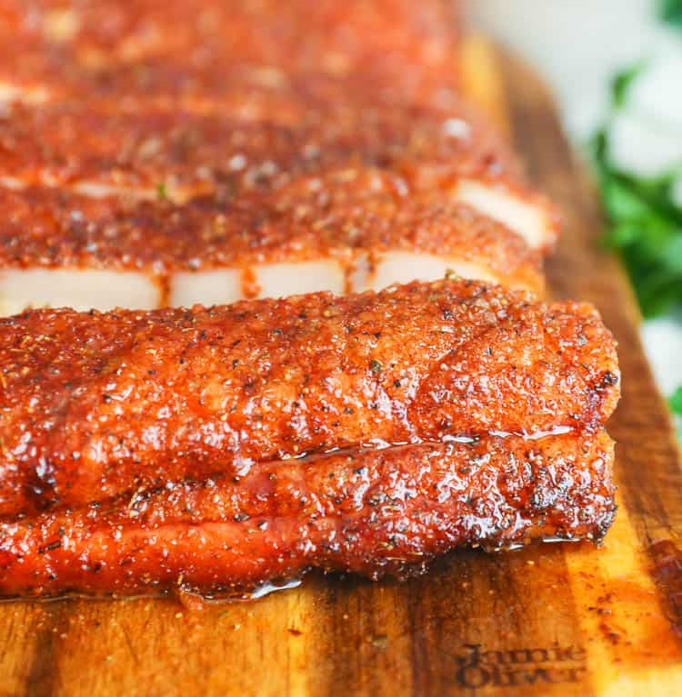 cross section of pork smoked belly on a chopping board