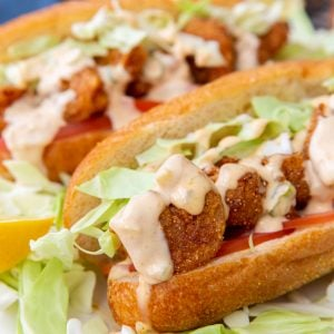 Upclose Shot Shrimp Po Boy Sandwich Drizzled with Remoulade Sauce