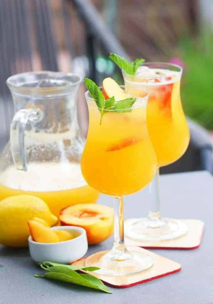 Peach Bellini in fancy glasses and pitcher