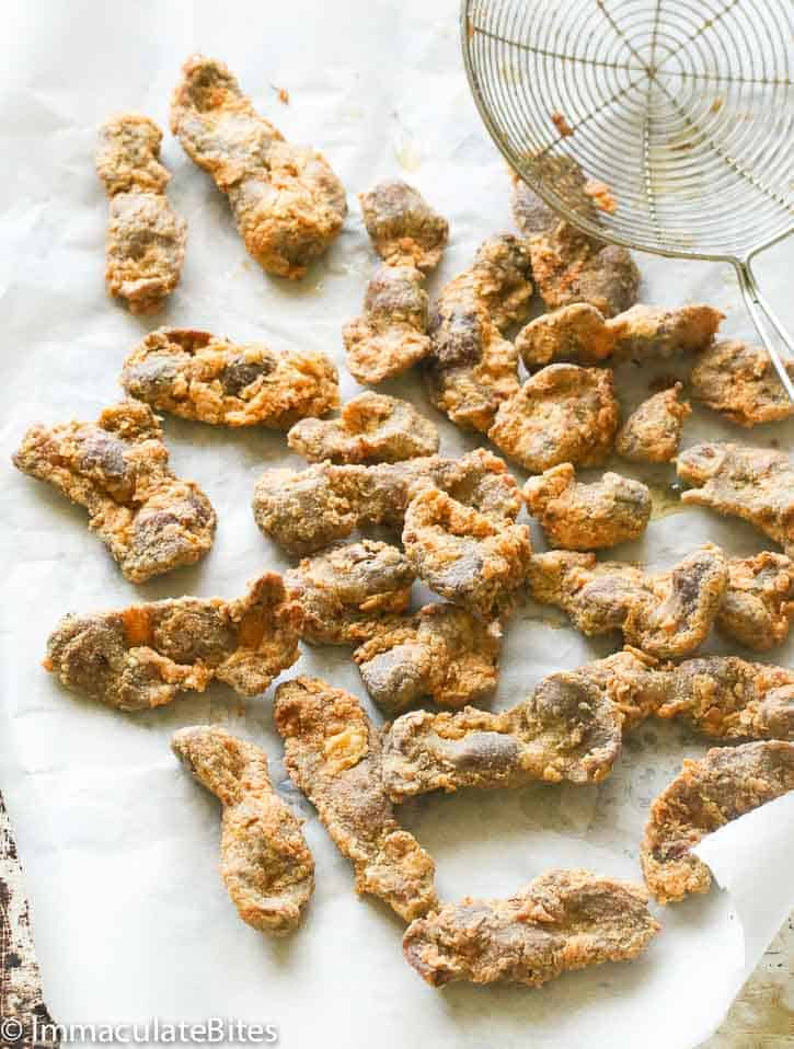 Fried chicken gizzards on a paper towel