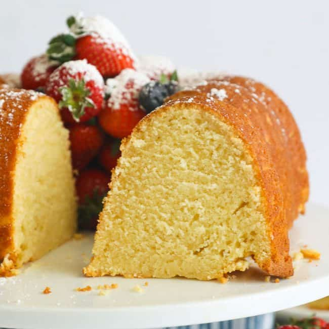 Sliced sour cream pound cake filled with fresh berries