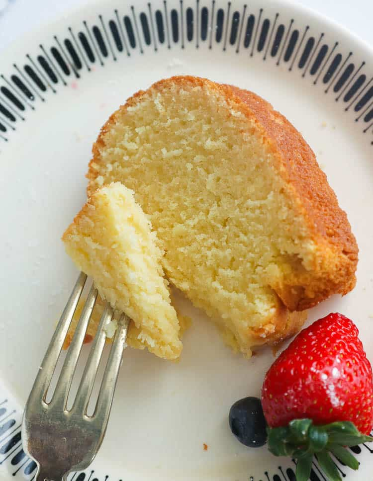 Slice of pound cake and as strawberry on a plate