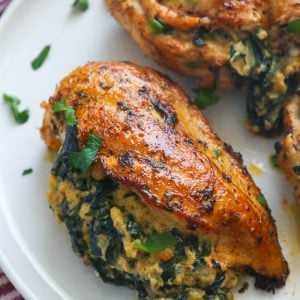 Stuffed Chicken Breasts on white plate