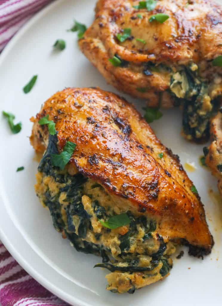 Spinach Stuffed Chicken Breasts on white plate