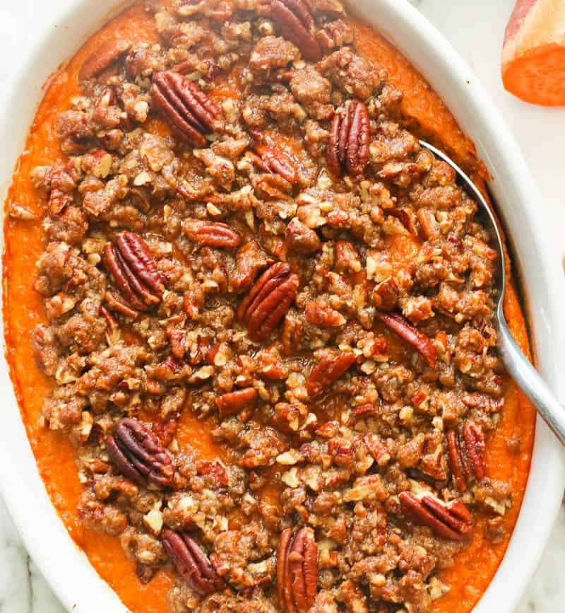 Freshly baked sweet potato casserole with pecans in a baking dish