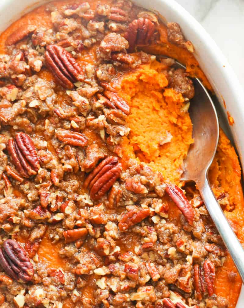 Scooped Out Sweet Potato Casserole topped with Pecans