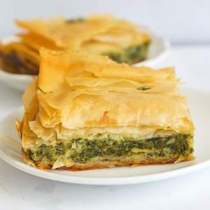 A Slice of Greek Spanokopita or Spinach Pie on a Plate