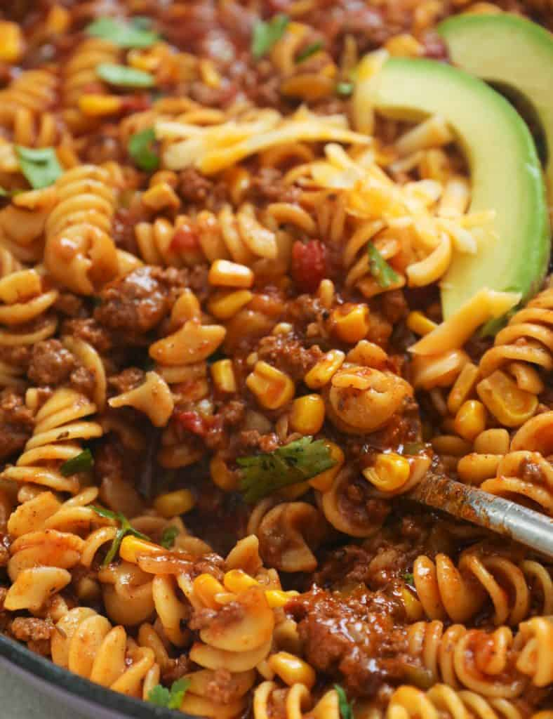 Taco Pasta Topped with Cheese and Avocado Slices