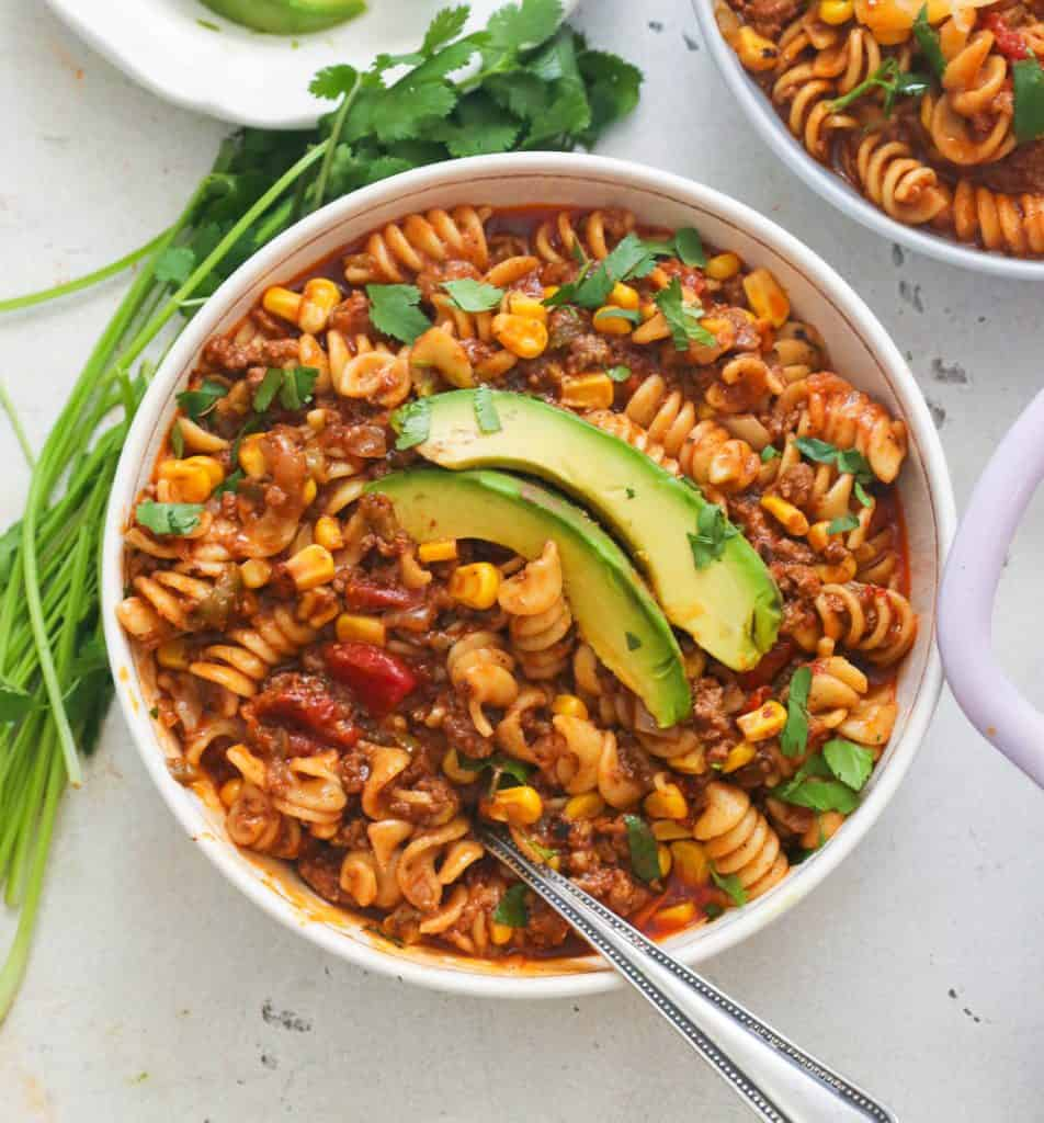 A Bowl of Taco Pasta Topped with Avocado Slices